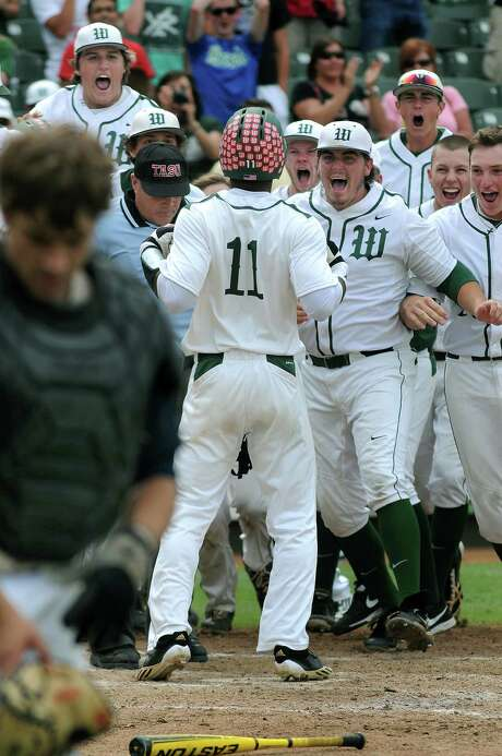 The Woodlands' Kolbi Brown (11) gets a hero's welcome after hitting a walk-off homer in the seventh. Photo: Jerry Baker, Freelance