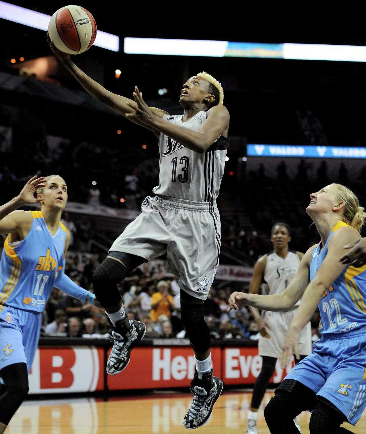 San Antonio Silver Stars' Danielle Robinson, center, shoots between Chicago Sky's Elena Delle Donne, left, and Courtney Vandersloot during the first half of a WNBA basketball game, Friday, June 7, 2013, in San Antonio. (Darren Abate/For the Express-News)