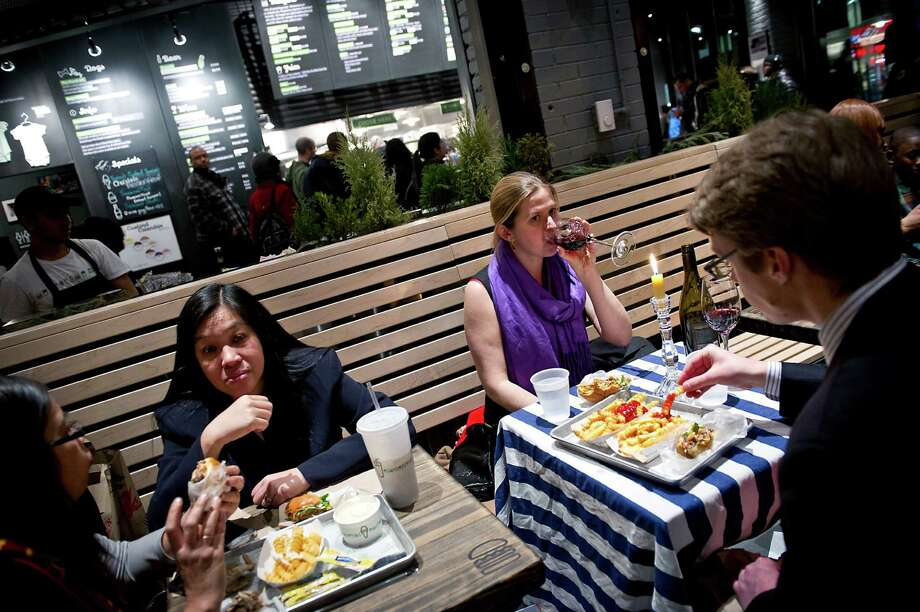 Among the millennials, like these diners at a Shake Shack in New York in 2012,  the 18- to 30-somethings are more interested in local foods and have a tendency to watch their dollars. Photo: EVAN SUNG, STR / NYTNS