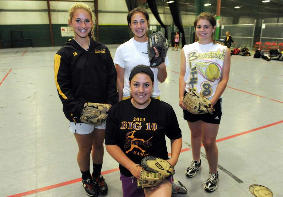 Troy High School softball players, left to right back, Hunter Levesque, Alina Germinerio, Kaitlin Delsignore and Victoria Hallett, front, on Friday June 7, 2013 in Clifton Park, N.Y. (Michael P. Farrell/Times Union) Photo: Michael P. Farrell