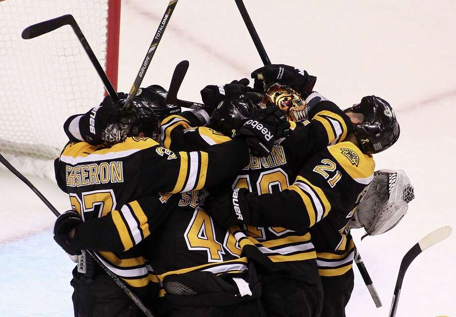 The Bruins celebrate winning a series in which they allowed only two goals to the Penguins. Photo: Alex Trautwig, Stringer / 2013 Getty Images