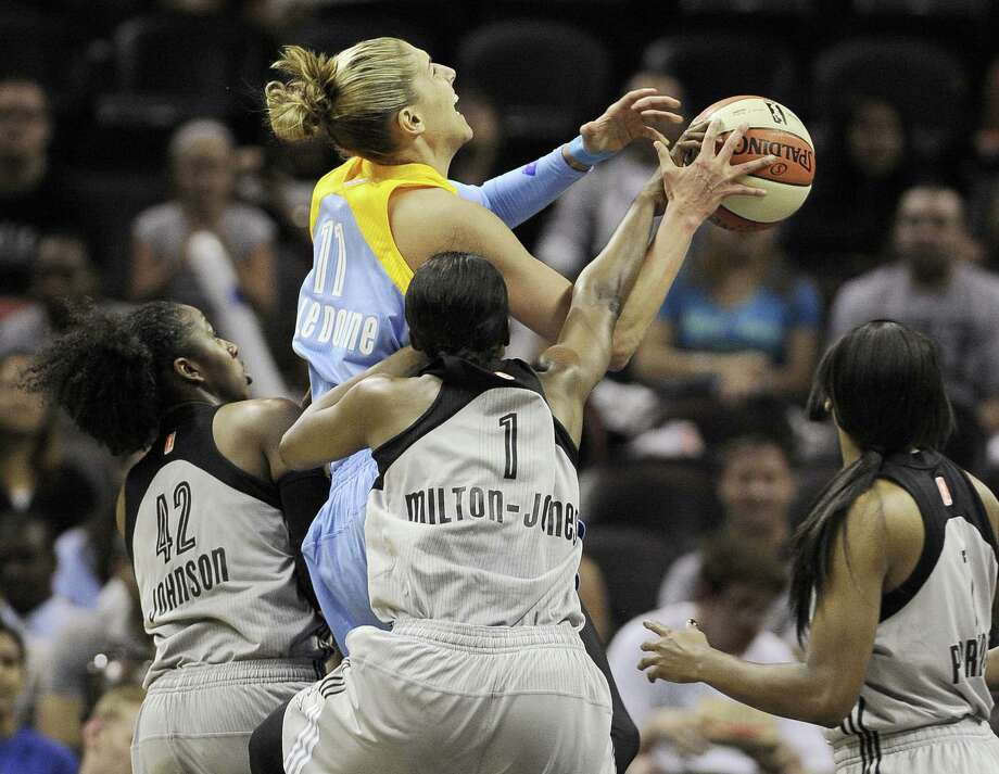 Chicago star rookie Elena Delle Donne (center) is hounded by Shenise Johnson (left), DeLisha Milton-Jones and Jia Perkins of the Silver Stars in the first half Friday. Photo: Darren Abate / For The Express-News