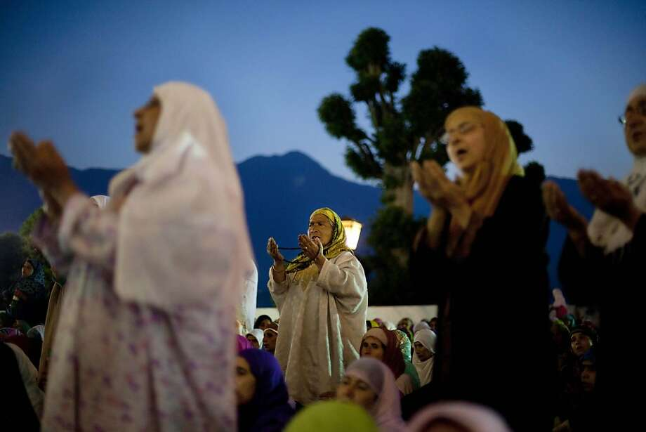 Kashmiri Muslim women pray early morning at the Hazratbal shrine, which houses a relic believed to be a hair from the beard of the Prophet on the occasion of  Mehraj-u-Alam, in the outskirts of Srinagar, India, Friday, June 7, 2013. Thousands of devotees thronged the shrine during Mehraj-u-Alam, believed to mark the ascension of Prophet Mohammed to Heaven. (AP Photo/Dar Yasin) Photo: Dar Yasin, Associated Press