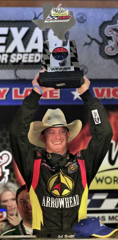 Jeb Burton shows off his trophy for winning the Camping World Trucks Series race at Texas Motor Speedway on Friday. Photo: John Rhodes, MBR / Fort Worth Star-Telegram