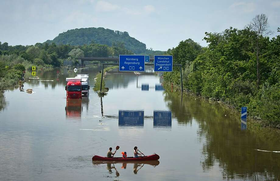 Germans paddle on the autobahn, where there's no speed limit on canoes, in 