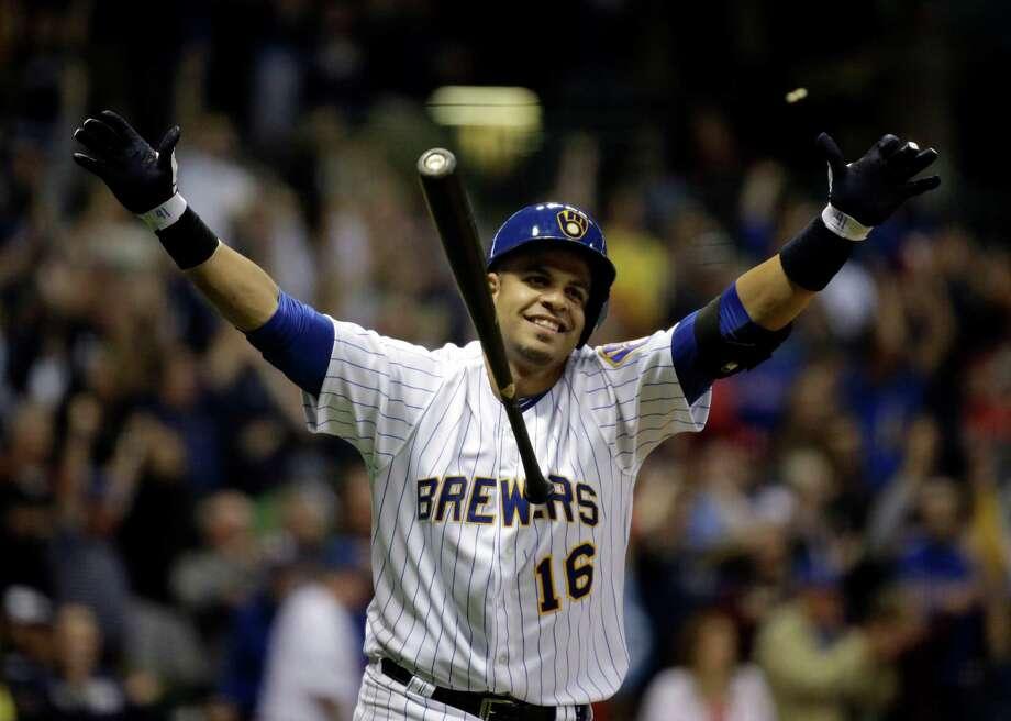 Milwaukee's Aramis Ramirez had no use for his bat after hitting a walk-off RBI single on Friday. Photo: Morry Gash, STF / AP