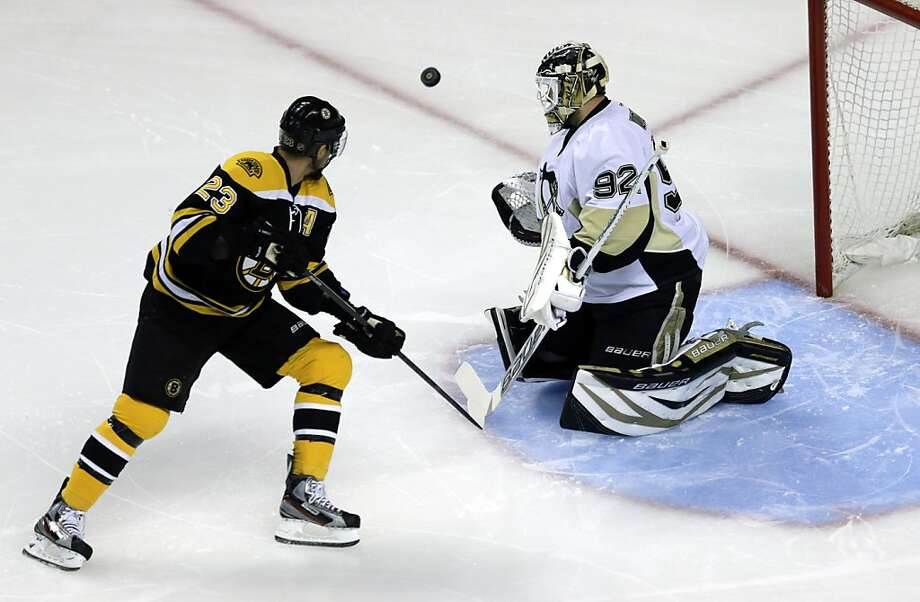 Pittsburgh Penguins goalie Tomas Vokoun (92) deflects the puck in front of Boston Bruins center Chris Kelly (23) during the first period of Game 4 in the Eastern Conference finals of the NHL hockey Stanley Cup playoffs, in Boston on Friday, June 7, 2013. (AP Photo/Charles Krupa) Photo: Charles Krupa, Associated Press