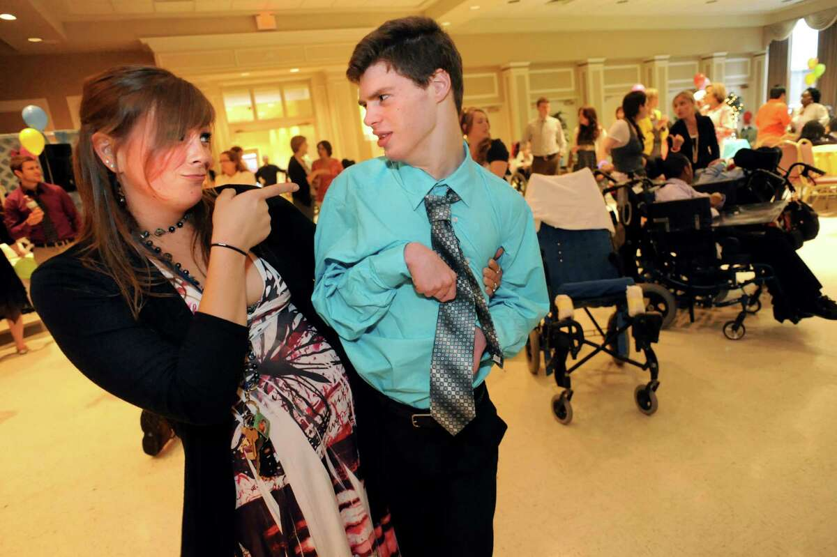Teaching assistant Eden Brand, left, dances with Royce Wooding, 21, during the annual Langan School Prom on Friday, June 7, 2013, at St. Sophia Greek Orthodox Church in Albany, N.Y. Students dressed their best, danced to a D.J.'s music and posed for official photos. The Langan School, which is for students who have disabilities or severe medical conditions, believes in offering students the same experiences as any other school. (Cindy Schultz / Times Union)