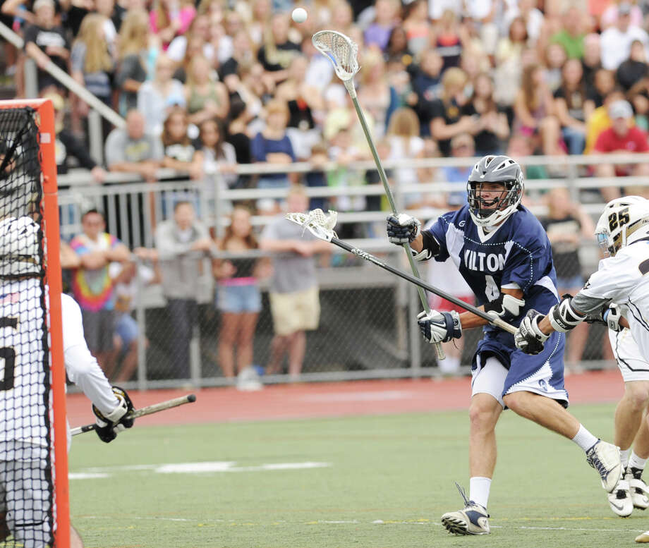 At right, Henry Lee of Wilton scores during the Division M boys high school lacrosse championship between Joel Barlow High School and Wilton High School at Brien McMahon High School in Norwalk, Saturday, June 8, 2013. Wilton took the title with a 9-4 victory. Photo: Bob Luckey / Greenwich Time