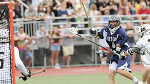 At right, Henry Lee of Wilton scores during the Division M boys high school lacrosse championship between Joel Barlow High School and Wilton High School at Brien McMahon High School in Norwalk, Saturday, June 8, 2013. Wilton took the title with a 9-4 victory.