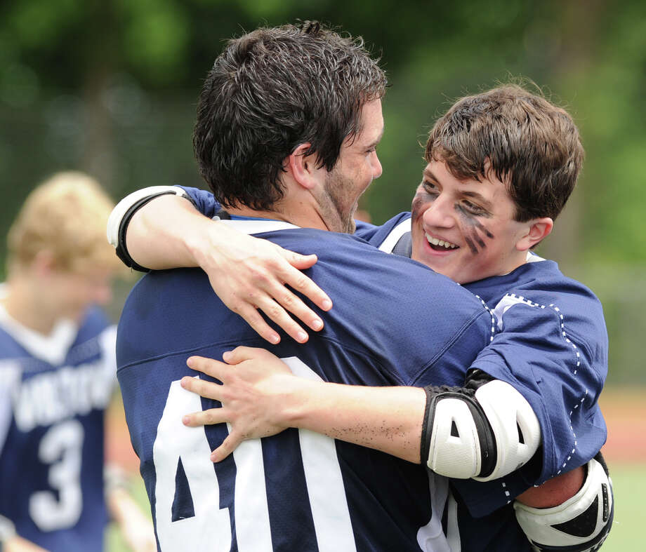 Wilton teammates, Mike LaSala (# 40) and Reid Melillo, right, (# 36), celebrate their team's 9-4 victory over Joel Barlow during the Division M boys high school lacrosse championship between Joel Barlow High School and Wilton High School at Brien McMahon High School in Norwalk, Saturday, June 8, 2013. Photo: Bob Luckey / Greenwich Time