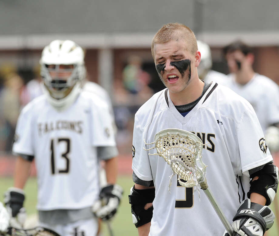At right, Conn Curry (# 9) of Joel Barlow walks off the field at the conclusion of the Division M boys high school lacrosse championship between Joel Barlow High School and Wilton High School at Brien McMahon High School in Norwalk, Saturday, June 8, 2013. Wilton took the title with a 9-4 victory. Photo: Bob Luckey / Greenwich Time