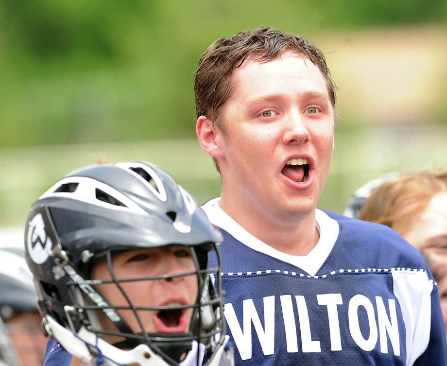 At right, Jack Armstrong of Wilton celebrates during the Division M boys high school lacrosse championship between Joel Barlow High School and Wilton High School at Brien McMahon High School in Norwalk, Saturday, June 8, 2013. Wilton took the title with a 9-4 victory. Photo: Bob Luckey / Greenwich Time