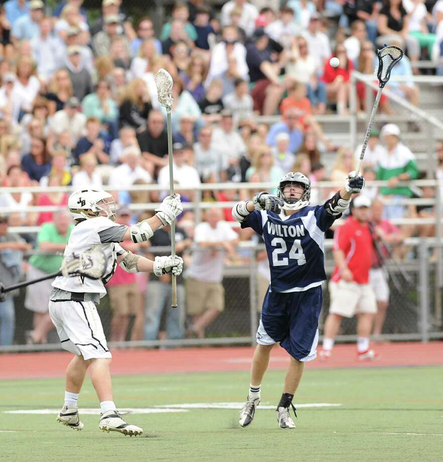 At right, Mike Burns (# 24) of Wilton during the Division M boys high school lacrosse championship between Joel Barlow High School and Wilton High School at Brien McMahon High School in Norwalk, Saturday, June 8, 2013. Wilton took the title with a 9-4 victory. Photo: Bob Luckey / Greenwich Time
