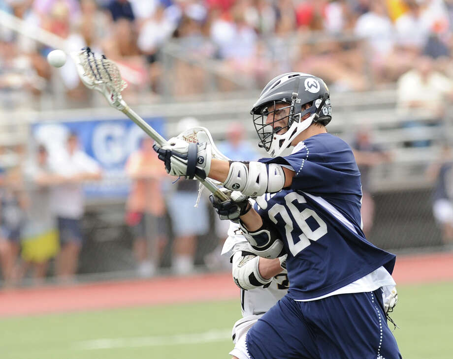 Thomas Hayes (# 26) of Wilton shoots during the Division M boys high school lacrosse championship between Joel Barlow High School and Wilton High School at Brien McMahon High School in Norwalk, Saturday, June 8, 2013. Wilton took the title with a 9-4 victory. Photo: Bob Luckey / Greenwich Time