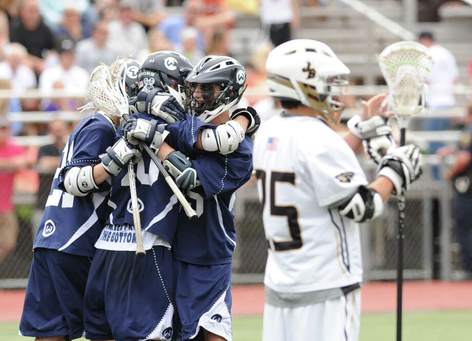 Wilton celebrates a goal by Dan Baird (center) during the Division M boys high school lacrosse championship between Joel Barlow High School and Wilton High School at Brien McMahon High School in Norwalk, Saturday, June 8, 2013. Wilton took the title with a 9-4 victory. Photo: Bob Luckey / Greenwich Time