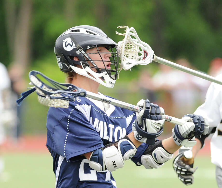 At left, Mike Burns (# 24) of Wilton during the Division M boys high school lacrosse championship between Joel Barlow High School and Wilton High School at Brien McMahon High School in Norwalk, Saturday, June 8, 2013. Wilton took the title with a 9-4 victory. Photo: Bob Luckey / Greenwich Time