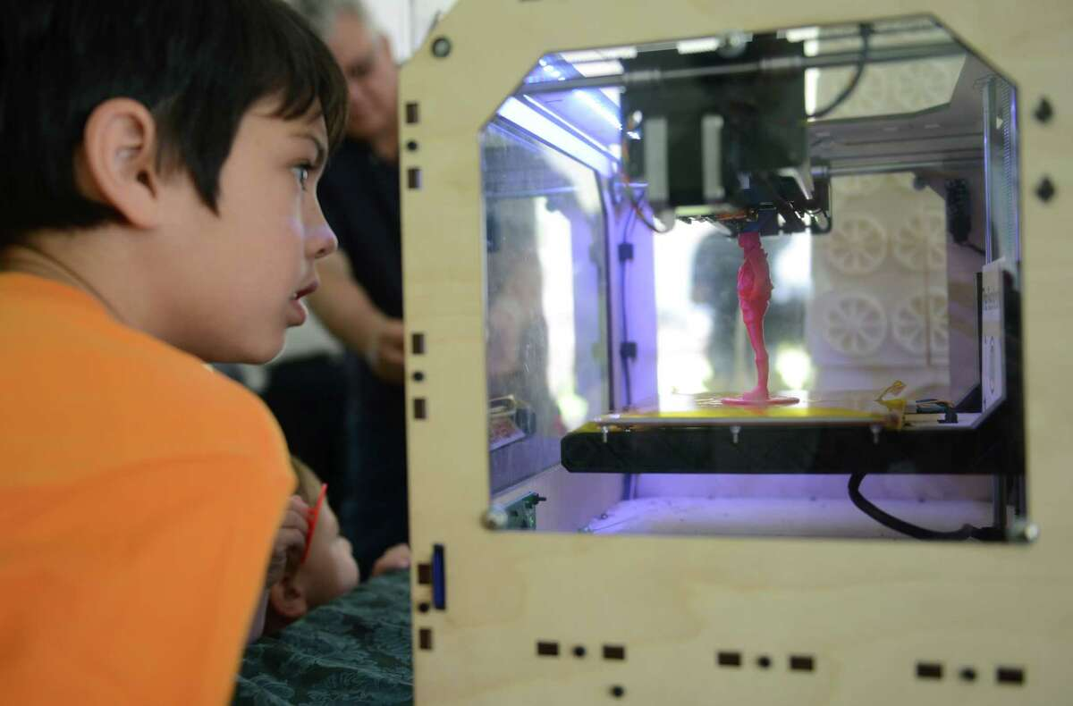 Karsten Groppe, 8, of Princeton, N.J., watches a 3D printing machine in action at the Danbury Mini Maker Faire at CityCenter Danbury Green on June 8, 2013. The festival featured dozens of exhibits from craftsmen, engineers, inventors and artists.
