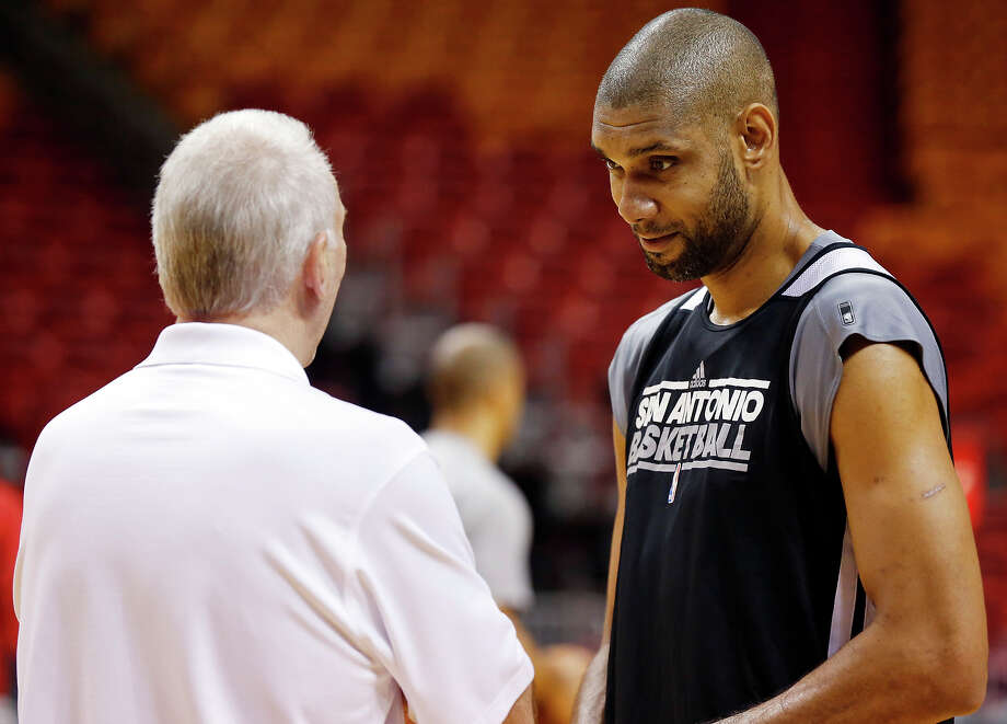 San Antonio Spurs head coach Gregg Popovich and San Antonio Spurs' Tim Duncan talk during practice Saturday June 8, 2013 at American Airlines Arena in Miami, Fla. Photo: Edward A. Ornelas, San Antonio Express-News / © 2013 San Antonio Express-News