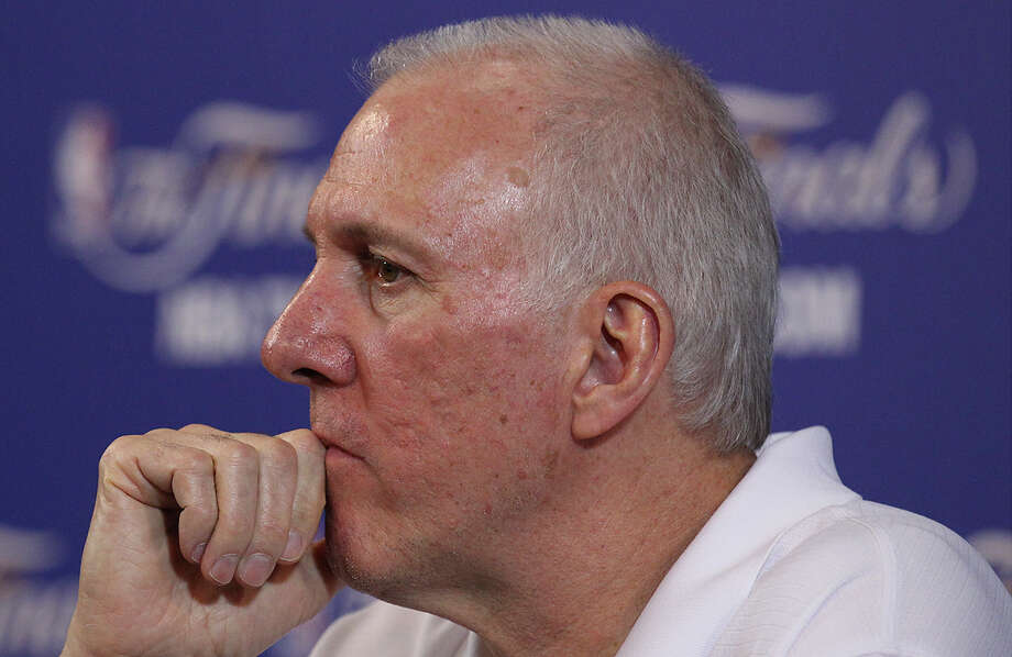 Spurs coach Gregg Popovich listens to questions during practice and media sessions at the American Airlines Arena in Miami on Saturday, June 8, 2013. Photo: Kin Man Hui, San Antonio Express-News / ©2013 San Antonio Express-News