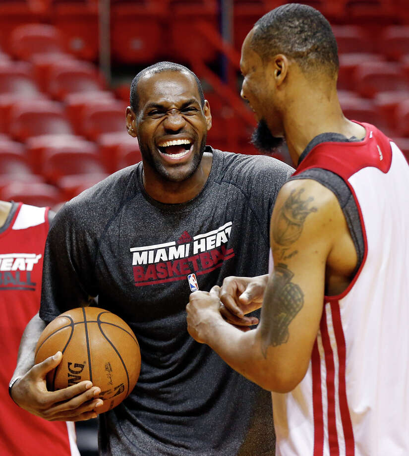Miami Heat's LeBron James and Miami Heat's Rashard Lewis joke during practice Saturday June 8, 2013 at American Airlines Arena in Miami, Fla. Photo: Edward A. Ornelas, San Antonio Express-News / © 2013 San Antonio Express-News