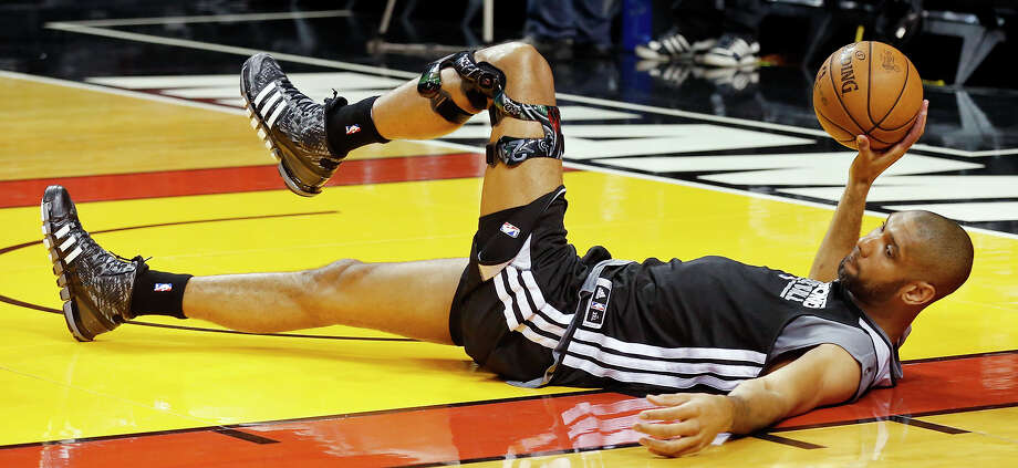 San Antonio Spurs' Tim Duncan stretches during practice Saturday June 8, 2013 at American Airlines Arena in Miami, Fla. Photo: Edward A. Ornelas, San Antonio Express-News / © 2013 San Antonio Express-News