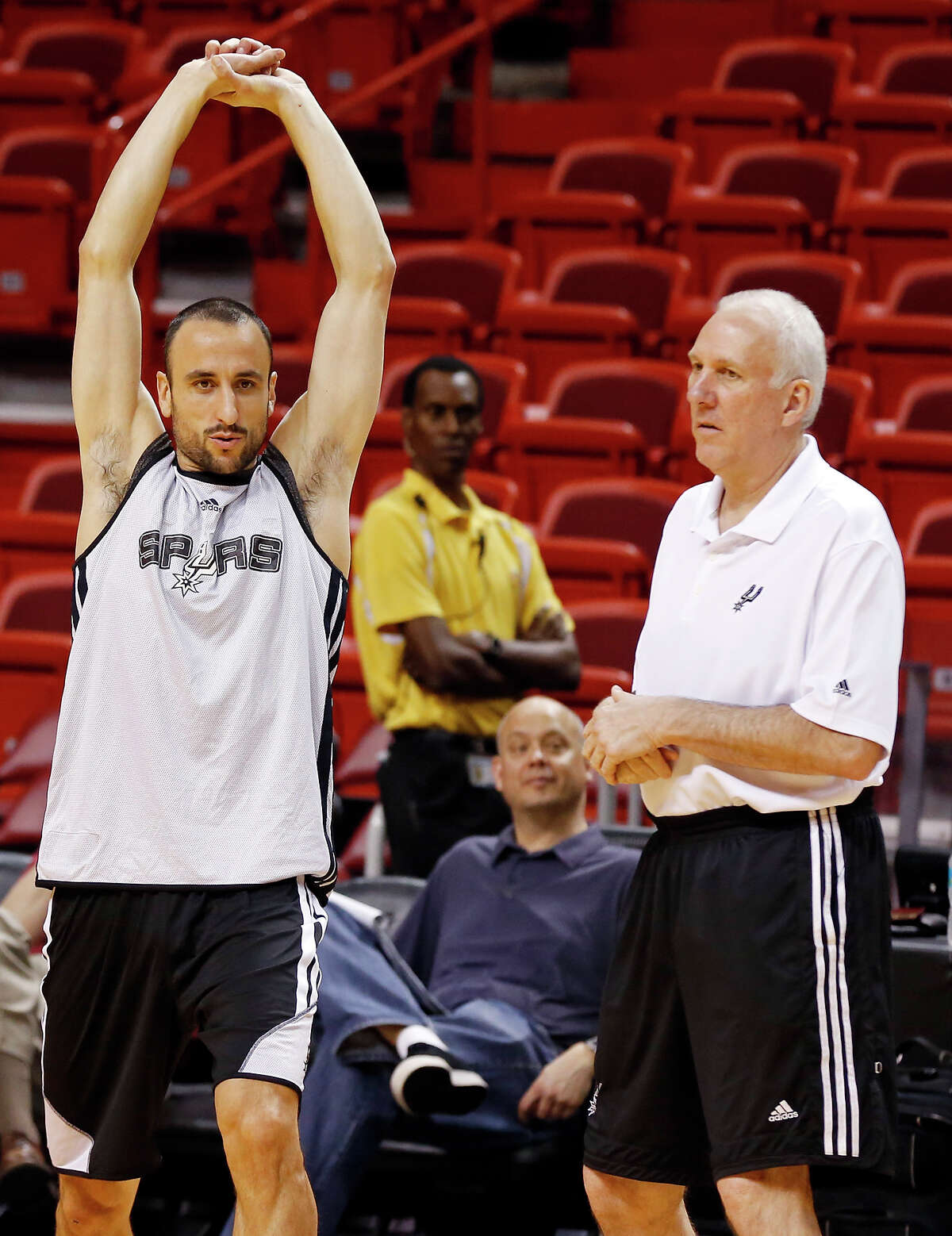 San Antonio Spurs' Manu Ginobili talks with San Antonio Spurs head coach Gregg Popovich during practice Saturday June 8, 2013 at American Airlines Arena in Miami, Fla.
