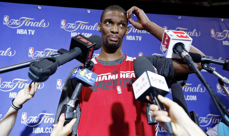 Miami Heat's Chris Bosh answers questions from the media during practice Saturday June 8, 2013 at American Airlines Arena in Miami, Fla. Photo: Edward A. Ornelas, San Antonio Express-News / © 2013 San Antonio Express-News