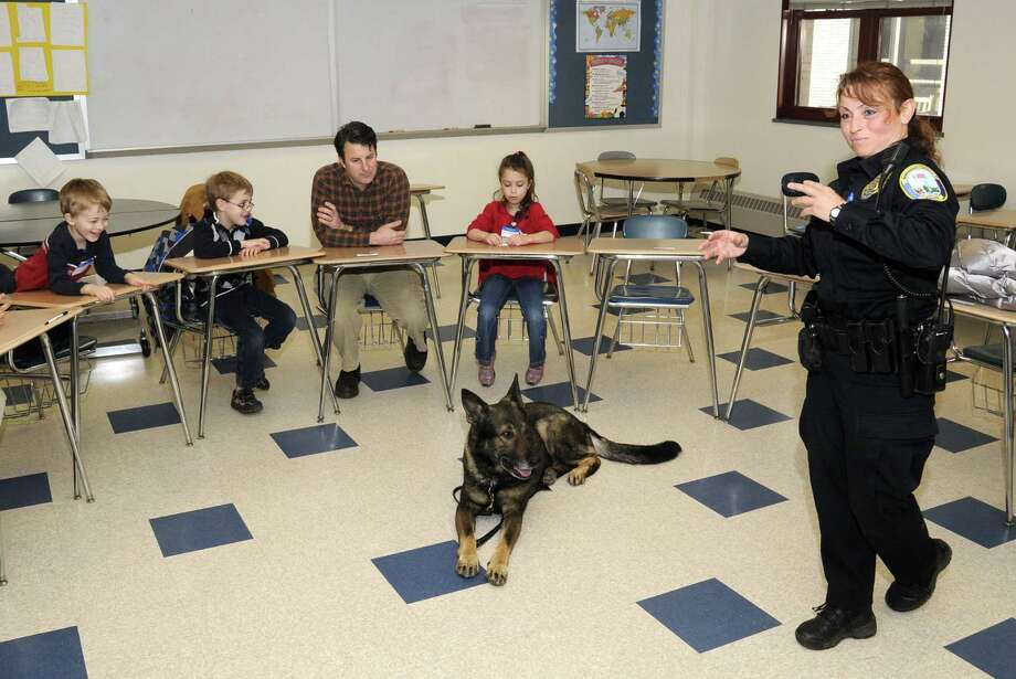 Newtown K9 officer, Felicia Figol, introduces a class of children to , Baro, the Newtown Police K9 dog, at the Discovery Science Workshops, held at Newtown High School, on Saturday, March 26, 2011. The workshops are organized by the Newtown Junior Women's Club, and the Newtown Board of Education. The Discovery Science Workshops are in its 17th year. Photo: Jay Weir, ST / The News-Times Freelance