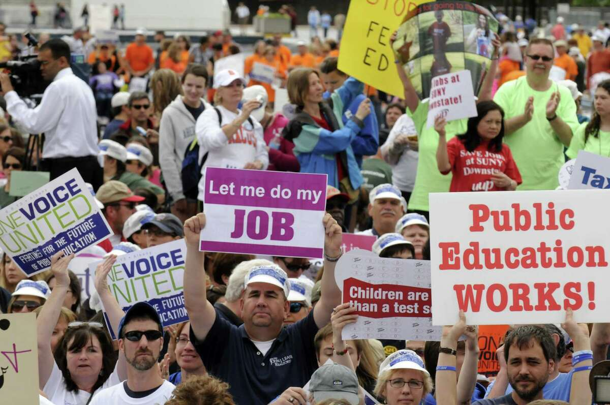 Educators and students take part in an education rally to press the fight for the future of public education at the Capitol on Saturday June 8, 2013 in Albany, N.Y. (Michael P. Farrell/Times Union)