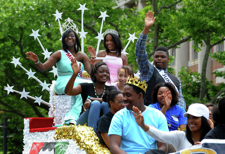 Members of the Bridgeport Young Adult Police Commissioners organization ride a float during the annual Juneteenth African-American Caribbean Parade and Festival in downtown Bridgeport, Conn. on Saturday June 8, 2013. Photo: Christian Abraham / Connecticut Post