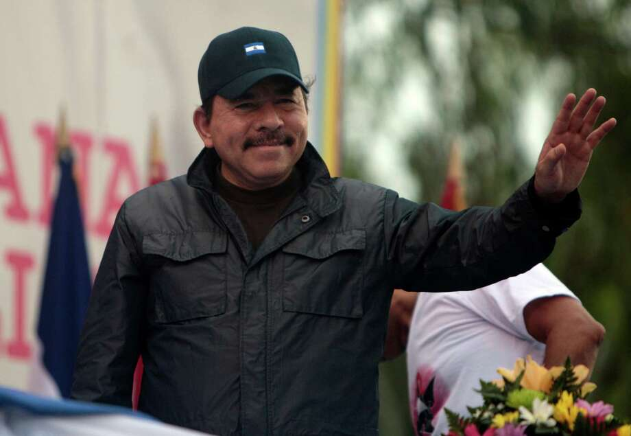 FILE - In this June 25, 2011 file photo, Nicaragua's President Daniel Ortega waves to supporters during an event marking the 32nd anniversary of the Sandinista's withdrawal to Masaya, in Managua, Nicaragua. Nicaragua is trying to revive a centuries-old dream of building an inter-ocean canal. Ortega presented the project to Congress June 4, 2013, and and hopes to submit it to at least an initial vote on June 7, 2013. (AP Photo/Esteban Felix, File) Photo: Esteban Felix, STF / AP