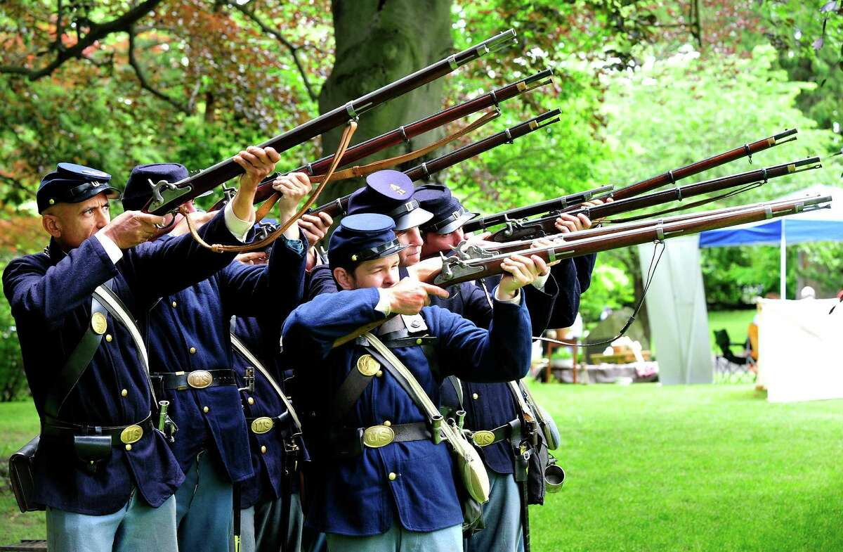 Members of the 11th Connecticut Volunteer Infantry drill during a Soldiers Fair, with re-enactors recreating camp life and expierences shared by Union soldiers 150 years ago, at Ballard park in Ridgefield, Conn. Saturday, June 8, 2012.