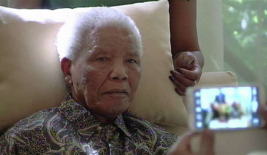 FILE - In this file image taken from video, the ailing anti-apartheid icon Nelson Madela is filmed Monday April 29, 2013, more than three weeks after being released from hospital.  The office of South Africa's president said Saturday, June 8, 2013 that Mandela has been taken to a hospital because of a lung infection.  SOUTH AFRICA OUT Photo: SABC TV