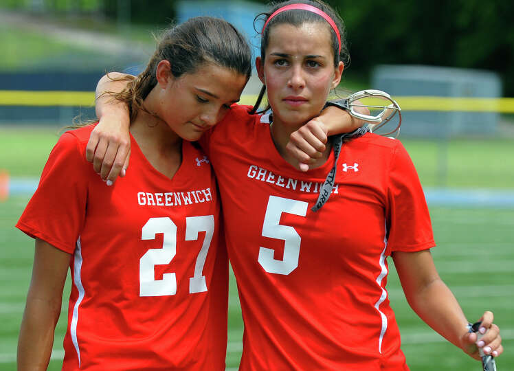 Greenwich's Carolyn Paletta, left, and teammate Emma Christie walk off the field after the team was