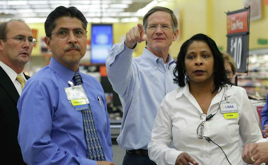 Congressman Lamar Smith, second from right, points as he asks a question during a tour of the Walmart store on 1604 at 281 on Friday, June 7, 2013. With Smith are David Drastata, Walmart Market Manager, left to right, Juan Zuniga, Store Manager at Austin Highway store, and Linda Baker, Co-Manager at the 1604 store. Photo: Bob Owen, San Antonio Express-News / © 2012 San Antonio Express-News