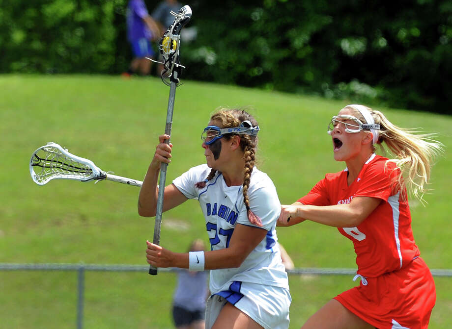 Greenwich's Molli Haimerl, right, tries to disrupt a drive to the goal by Darien's Taylor Hardison, during Class L lacrosse finals action in Stratford, Conn. on Saturday June 8, 2013. Hardison was able to score a goal. Photo: Christian Abraham / Connecticut Post