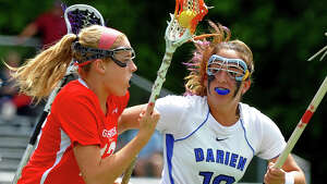 Greenwich'sJenny Goggin, left, drives the ball as Darien's Jena Fritts tracks her, during Class L lacrosse finals action in Stratford, Conn. on Saturday June 8, 2013.