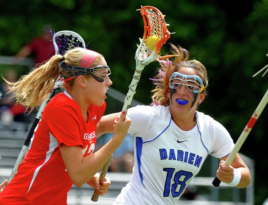 Greenwich'sJenny Goggin, left, drives the ball as Darien's Jena Fritts tracks her, during Class L lacrosse finals action in Stratford, Conn. on Saturday June 8, 2013. Photo: Christian Abraham / Connecticut Post