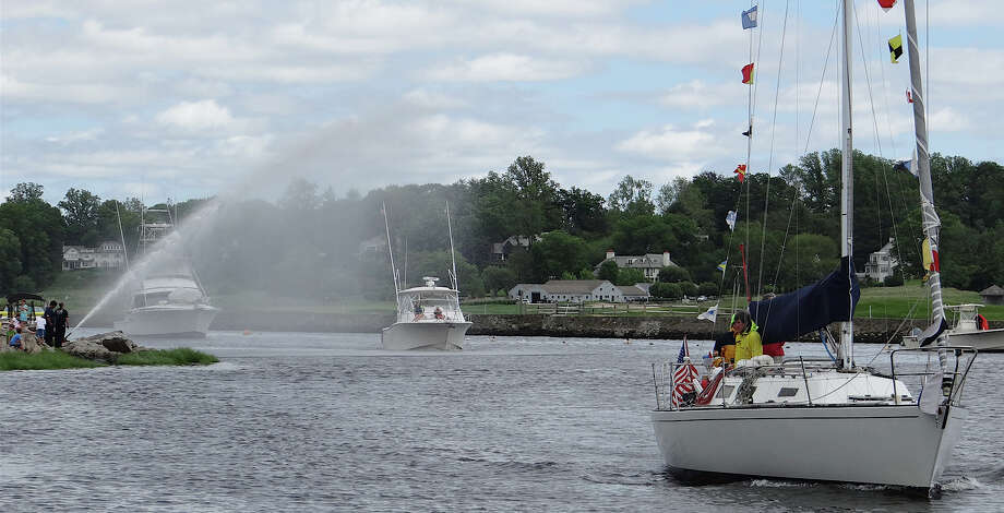 A procession of vessels proceed through Southport Harbor on Saturday during the annual Blessing of the Fleet.  FAIRFIELD CITIZEN, CT 6/8/13 Photo: Mike Lauterborn / Fairfield Citizen contributed