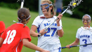 Darien's Taylor Hardison, during Class L lacrosse finals action against Greenwich in Stratford, Conn. on Saturday June 8, 2013.