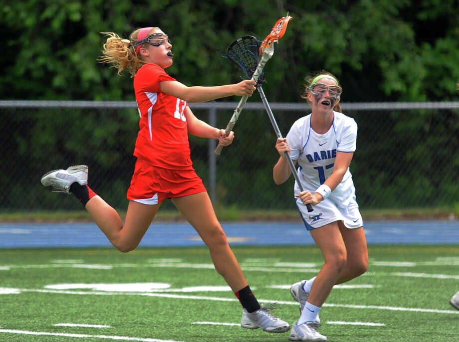 Greenwich's Jenny Goggin, left, attempts a last second goal against Darien, during Class L lacrosse finals action in Stratford, Conn. on Saturday June 8, 2013. Photo: Christian Abraham / Connecticut Post