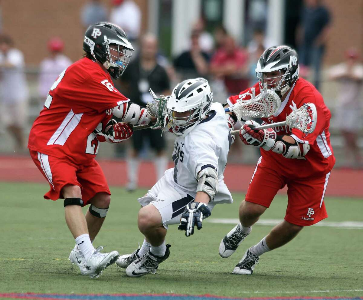 Colin Bannon of Staples finds himself trapped between Fairfield Prep's Tim Edmonds and Kevin Brown during fourth quarter Class L lacrosse action in Norwalk. Prep scored 6 fourth quqrter goals to win-14-8. © J. Gregory Raymond for C. Post