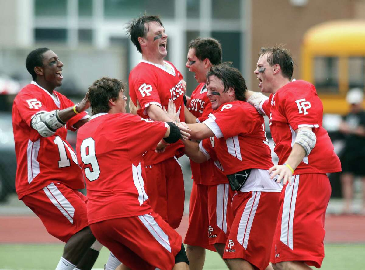 Players of the Fairfield Prep lacrosse team share a moment of glory following their 14-8 win over Staples to win the class L CIAC lacrosse title in Norwalk on Saturday. Prep scored 6 unanswered goals in the fourth quarter to win, 14-8.© J. Gregory Raymond for the Ct. Post.