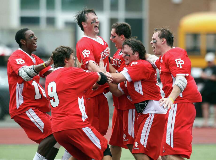 Players  of the Fairfield Prep lacrosse team share a moment of glory following their 14-8 win over Staples to win the class L CIAC lacrosse title in Norwalk on Saturday. Prep scored 6 unanswered goals in the fourth quarter to win, 14-8.© J. Gregory Raymond for the Ct. Post. Photo: J. Gregory Raymond / Stamford Advocate Freelance;  © J. Gregory Raymond