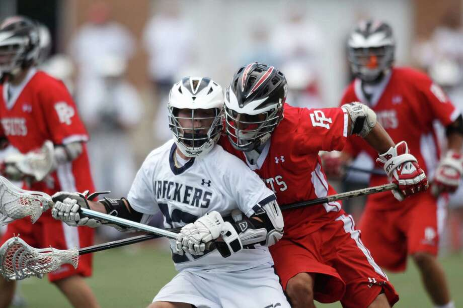 Staples middie Joey Zelkowoitz finds his path to the goal blocked by Fairfield Prep's Andrew Hatton during the Class L lacrosse final in Norwalk on Saturday. Prep scored 6 fourth quarter goals to win, 14-8. © J. Gregory Raymond for C. Post. Photo: J. Gregory Raymond / Stamford Advocate Freelance;  © J. Gregory Raymond