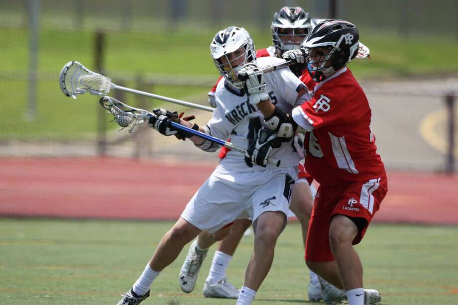 Staples attackman Colin Bannon finds his path to the cage blocked by Steven Walsh during class L lacrosse action in Norwalk on Saturday. Prep dominated the fourth quarter to win, 14-8. © J. Gregory Raymond for the Ct. Post Photo: J. Gregory Raymond / Stamford Advocate Freelance;  © J. Gregory Raymond