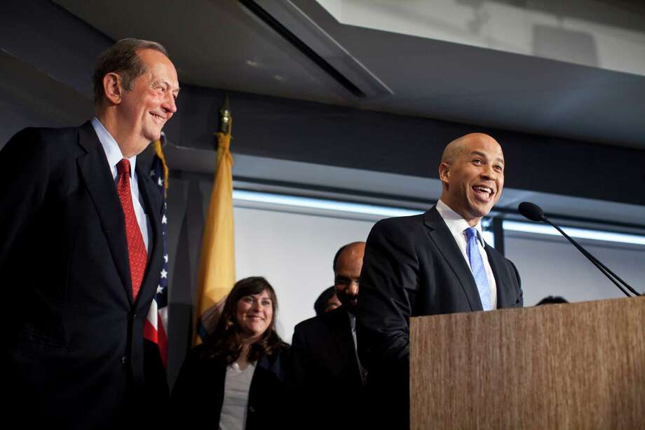 NEWARK, NJ - JUNE 8: Former U.S. Senator Bill Bradley (L) listens as Newark Mayor Cory Booker speaks during a news conference to discuss his plans to campaign for the Democratic nomination to run for the seat of late U.S. Sen. Frank Lautenberg on June 8, 2013 in Newark, New Jersey. New Jersey Governor Chris Christie has set October 16th as the date for a special election to determine who will fill Lautenberg's seat for a year. Photo: Ramin Talaie, Getty Images / 2013 Getty Images