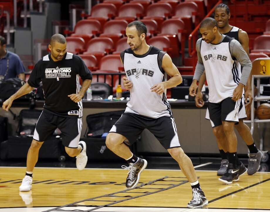 San Antonio Spurs' Tony Parker, Manu Ginobili, Gary Neal and Kawhi Leonard run drills during practice Saturday, June 8, 2013, at American Airlines Arena in Miami, Fla. (Edward A. Ornelas / San Antonio Express-News)