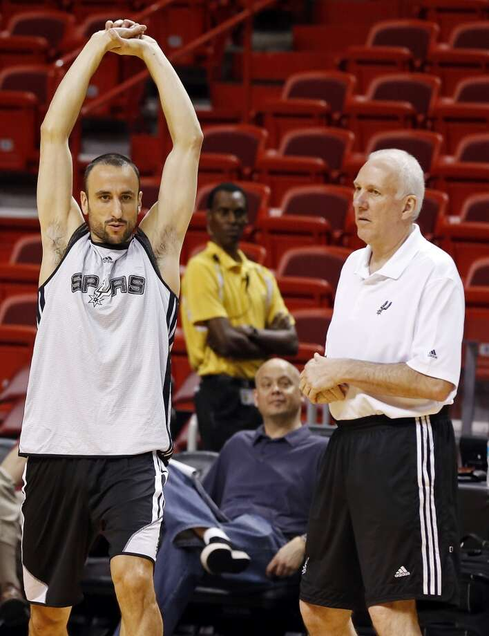 San Antonio Spurs' Manu Ginobili talks with head coach Gregg Popovich during practice Saturday, June 8, 2013, at American Airlines Arena in Miami, Fla. (Edward A. Ornelas / San Antonio Express-News)